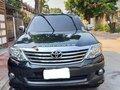 Black Toyota Fortuner 2013 SUV / MPV for sale in Quezon City-0