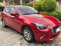 Red Mazda 2 for sale in Pacita Complex-4