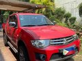 Selling Red Mitsubishi Strada 2013 in Quezon-8