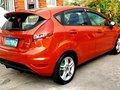 Selling Orange Ford Fiesta 2013-1