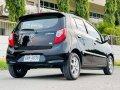 Black Toyota Wigo 2014 for sale in Noveleta-9