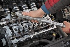 What does a car engine camshaft do?