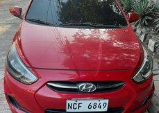 Red Hyundai Accent hatchback 2016