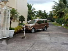 Isuzu XUVi Limited lifted with hitch