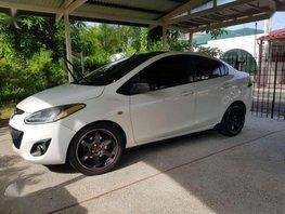 Mazda 2 2010 15 AT White Sedan for sale