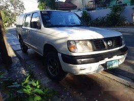 White Nissan Frontier 2010 at 70000 km for sale in Quezon City