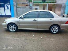 Selling Mitsubishi Lancer 2003 Automatic Gasoline in Santo Tomas