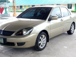Selling 2nd Hand Mitsubishi Lancer 2009 Manual Gasoline at 120000 km in Pulilan