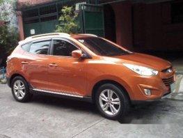 Orange Hyundai Tucson 2013 at 39125 km for sale