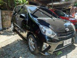 Sell Black 2014 Toyota Wigo in Quezon City