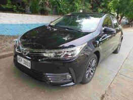 Black Toyota Corolla Altis 2018 at 15000 km for sale