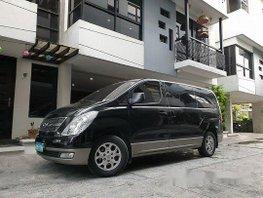 Black Hyundai Grand Starex 2014 at 47000 km for sale