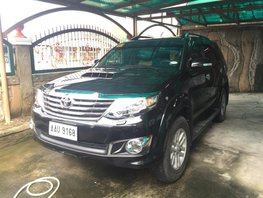 Selling Black Toyota Fortuner 2014 at 34000 km