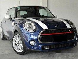 Selling Blue Mini Cooper 2015 at 18000 km