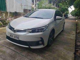 Selling White Toyota Corolla Altis 2018 Automatic Gasoline at 7000 km