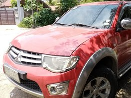Selling Red Mitsubishi Strada 2012 at 60000 km