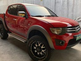 Selling Red Mitsubishi Strada 2011 Truck in Quezon City