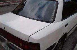 1995 Mazda 323 all original color white