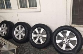 Nissan armada Pull out rims 20 with NEW Nitto terra grappler 305 55 20