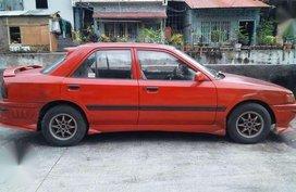Mazda 323 1995 MT Red Fpr Sale