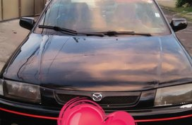 98 mdl Mazda Familia rayban for sale