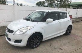 2012 Suzuki Swift AT White Hatchback For Sale
