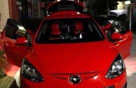 For sale Mazda 2 red hatch back Model 2011