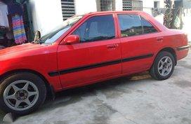 Mazda 323 sedan Good running condition