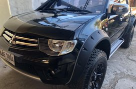 2014 Mitsubishi Strada GLS sport ( black )