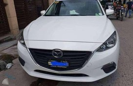 2016 Mazda 3 1.6L A/T. Arctic White color.