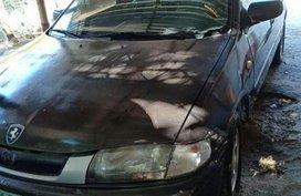 Like new Mazda 323 sedan for sale