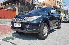 Selling Black Mitsubishi Strada 2016 Manual Diesel at 35000 km in Quezon City
