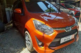 Selling Orange Toyota Wigo 2019 Manual Gasoline in Quezon City