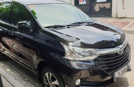 Selling Black Toyota Avanza 2018 Automatic Gasoline for sale in Quezon City