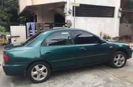 Selling Mazda 323 1997 Manual Gasoline in Meycauayan