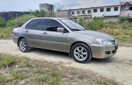 Selling 2004 Mitsubishi Lancer for sale in Consolacion
