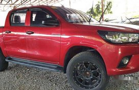 Selling Red Toyota Hilux 2018 at 8000 km in Quezon City