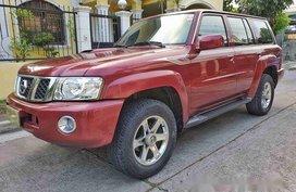 Selling Red Nissan Patrol Super Safari 2013 at 30000 km