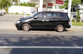 Selling Black Kia Carnival 2001 120000 km in Lipa