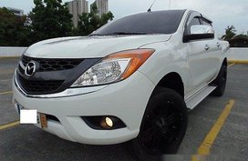 Selling White Mazda Bt-50 2014 at 28000 km in Quezon City