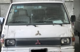 Selling White Mitsubishi L300 2010 Van in Mandaue