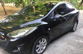 Black Mazda 2 2010 Sedan at 134000 km for sale