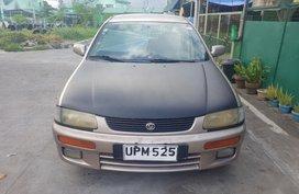 Selling 1997 Mazda 2 Sedan for sale in Lipa