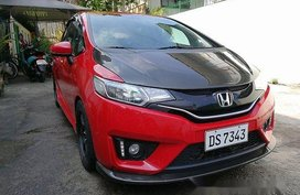 Red Honda Jazz 2016 at 31000 km for sale