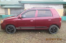Maroon Suzuki Alto 2013 Manual for sale