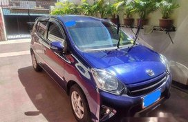Blue Toyota Wigo 2016 at 26000 km for sale in Makati