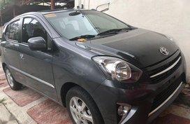 Gray Toyota Wigo 2015 Hatchback Manual Gasoline for sale in Quezon City