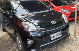Black Toyota Wigo 2014 Automatic Gasoline for sale in Quezon City