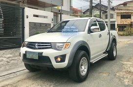 Sell White 2012 Mitsubishi Strada in Pasig