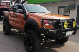 Orange Ford Ranger 2015 at 20000 km for sale